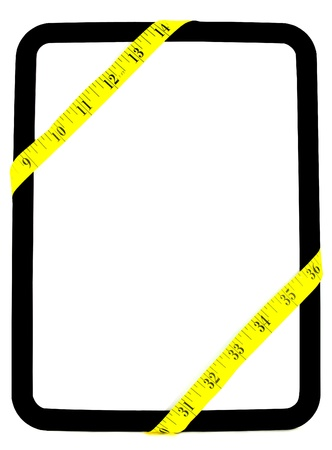 Yellow weight measuring tape wrapped around white and black dry erase background board Stock Photo