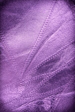 Purple leather textured close up background