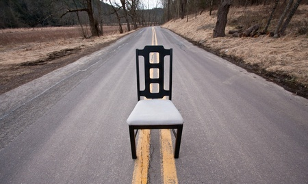 sit: Black chair in the middle of the road Stock Photo