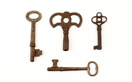 Rare antique keys together isolated on white