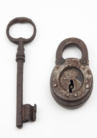 Antique lock and key together isolated on white Stock Photo