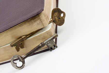 protection of the bible: Two keys by a leather book. One key stuck inside as a book mark Stock Photo