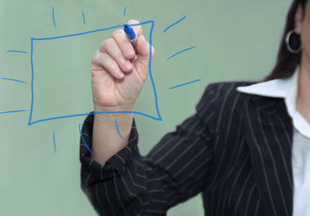 Businesswoman with pen drawing a blue chart with green background