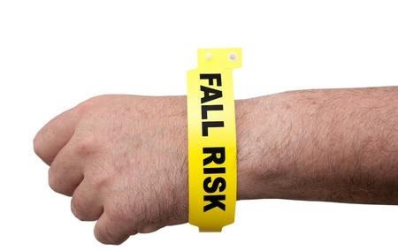 Elderly man wearing a hospital medical ID bracelet around his arm Stock Photo - 13916530
