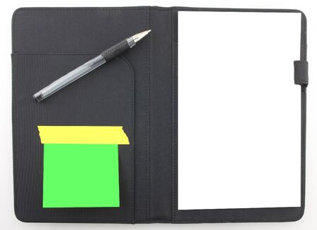 notebook: Business agenda planner with paper and a black pen. Post it notes Stock Photo
