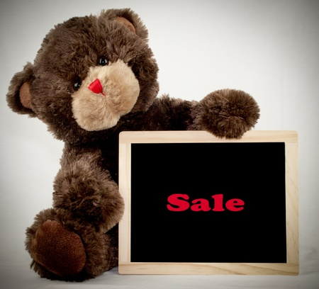 A brown bear holding a sale chalkboard Stock Photo