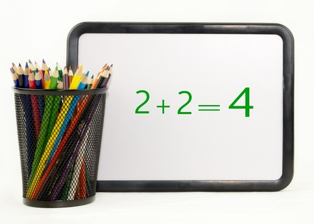 dry erase: Colored pencils in a holder with math dry erase board isolated on white