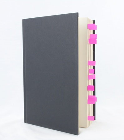 Pink bookmarks in a standing book