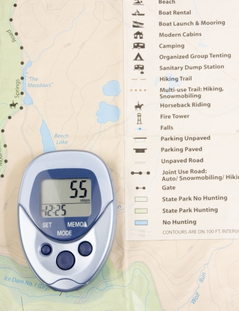 Blue pedometer with a map in background Stock Photo
