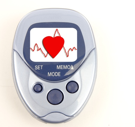 step well: Heart and heartbeat on the face of a blue pedometer isolated on white Stock Photo