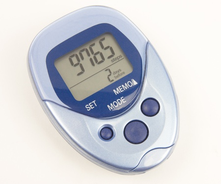 step well: A blue pedometer isolated on a white background Stock Photo