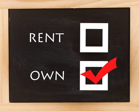 A sign that has rent or own on a black chalkboard with a red checkmark