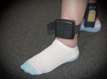 arrested: A house arrest ankle bracelet on Stock Photo