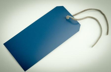Faded antike blau-Tag auf einem grauen Hintergrund Standard-Bild - 20665483