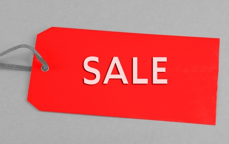 Red sale tag with gray background
