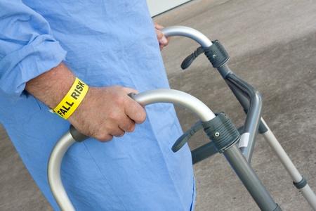 A hospital patient wearing a fall risk bracelet using a walker Stock Photo - 20886402