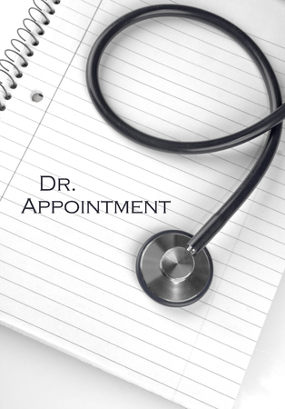 dr: Dr. Appointment text on a notepad with a stethoscope