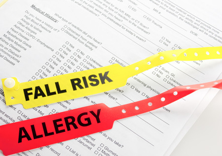 Fall Risk And Allergy Bracelet on top of a hospital questionnaire Stock Photo