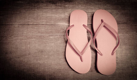 Flip-flops vintage pink color on a wooden  Stock Photo