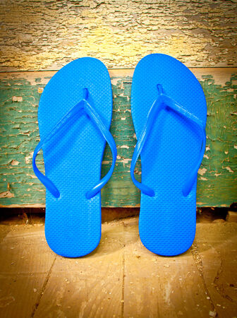 Flip-flops leaning against a house