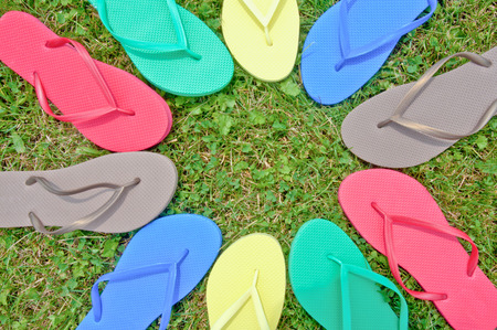 Flip-flops in a circle in the grass Stock Photo