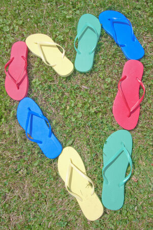 Flip-flops heart shaped in the grass Stock Photo