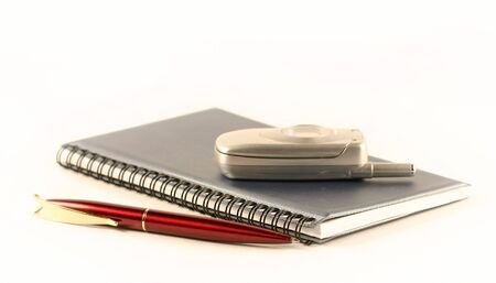 The pen, notebook and mobile phone Stock Photo