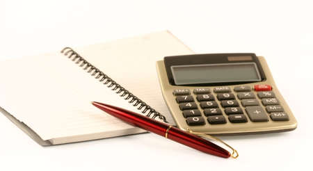 The pen, notebook and the calculator Stock Photo