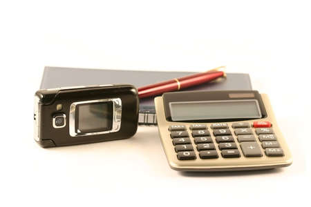 year financial statements: The pen, notebook, the calculator and mobile phone Stock Photo