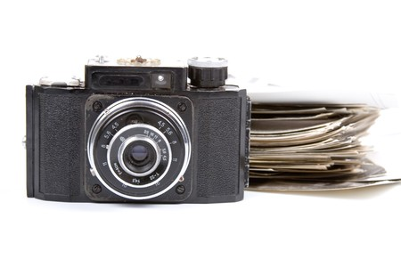 Old camera and pictures on a white background