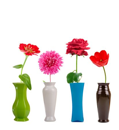 Flowers in a vase isolated on white background photo