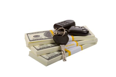 car keys on the package of dollars  isolated on a white background Stockfoto