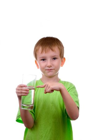 big toe: boy pointed to a glass of water with your finger on a white background Stock Photo