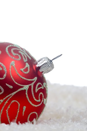 Red christmas ball with snow isolated on white background photo