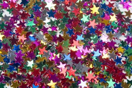 donative: Background of multicolored glittering stars, Christmas ornaments