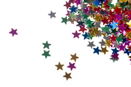 donative: Multicolored glittering stars on a white background, Christmas decorations Stock Photo