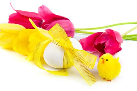 Easter eggs and tulips on a white background photo
