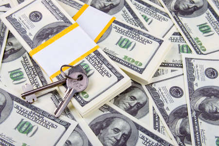 downpayment: Keys of one hundred dollar bills background  Stock Photo