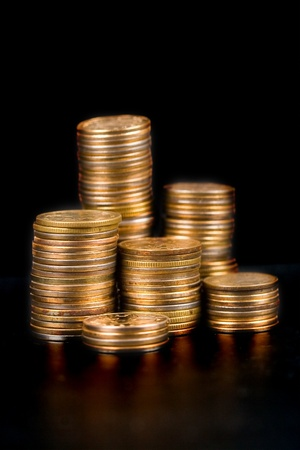Piles of gold coins on a black background  Stock Photo - 8892997