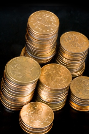 Piles of gold coins on a black background  photo