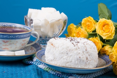 Romantic tea.  Tea,  cake  and  roses  on a blue background. Valentines Day photo