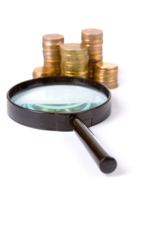 Piles of gold coins and magnifying glass on a white background  Stock Photo - 8988184