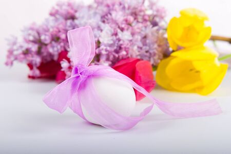 Easter egg and tulips on a white background photo