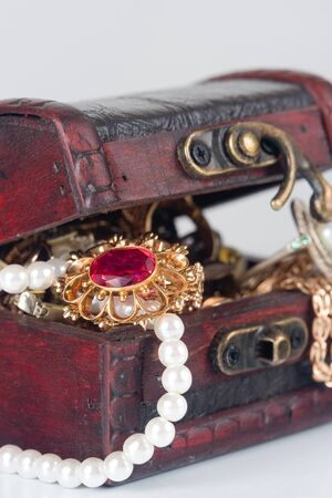 Brown chest with treasures  on a gray background Stock Photo - 9399255