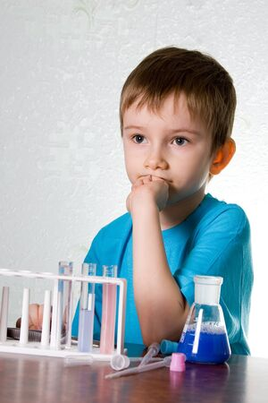 Boy plays in the academic chemist  photo