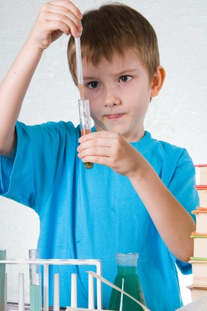 Boy plays in the academic chemist  Stock Photo