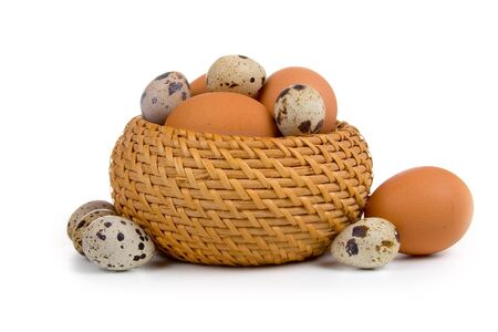 Eggs in the basket on a white background  photo