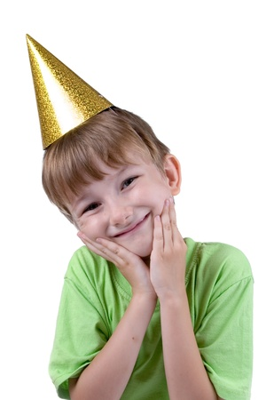 Cheerful boy in a festive hat isolated on a white background Stock Photo