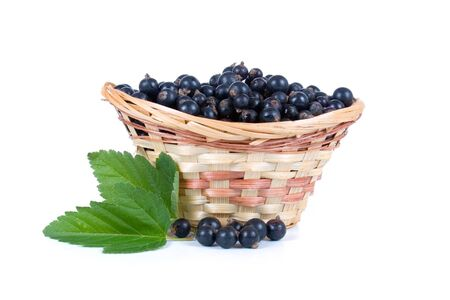 Fresh berries in a wicker basket isolated on a white background Stock Photo