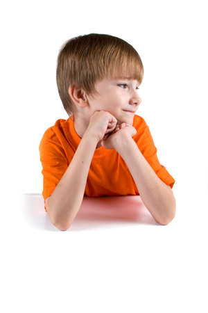 Cheerful pensive boy isolated on a white background